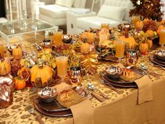 Festive Thanksgiving: Fake gourds, flowerpot molds, fall leaves, branches and lots of copper (from the charger plates to the three-tiered dessert stand) blend together in Sandra Lee's turkey-day tablescape to create an earthy, metallic decor. Thanksgiving Table Settings, Thanksgiving Tablescapes, Thanksgiving Recipes, Happy Thanksgiving, Thanksgiving Turkey, Thanksgiving Wedding, Thanksgiving Celebration, Holiday Dinner, Happy Fall