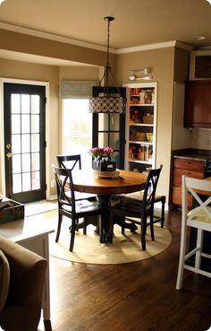 I have the chairs, I need to paint my table bottom black to match my black and straw chairs. I love the door on the pantry!
