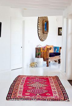 white floors-----Kilim rugs and colors against all white