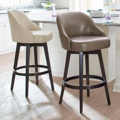 The kind of mid-century modern style that brings the chic and the swivel, our Isaac Bar Stool is all kinds of wonderful. A clean-lined, curved, and    comfortable seat is paired with smooth wood legs. There a built-in swivel mechanism, so you can smoothly turn this way to talk to a suave ad man    over your martini, and that way to enjoy some tapas and gaze at a famous international singer (or just feel that way in the comfort of your home). A metal    kick plate finishes the look. Gorgeo...
