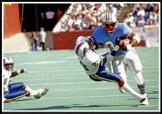 Oilers...Earl Campbell... NFL Hall of Famer...this scene is was typical when Earl Campbell ran