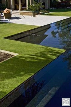 A great reflection style pool using black tiling to enhance the mirror effect. The lawn right up to the edge gives a lovely natural feel of vegetation meets water Outdoor Pool, Outdoor Gardens, Outdoor Spaces, Swimming Pool Designs, Swimming Pools, Landscape Design, Garden Design, Patio Design, Pool Water Features