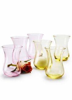 3 3/4IN PINK & YELLOW VASES THESE BUD VASES ARE MADE OF GENUINE COLORED GLASS. THEY MAKE A GREAT BUD VASE OR HOLD A SMALL ARRANGEMENT, BUT THEY CAN ALSO BE USED AS VOTIVE HOLDERS.