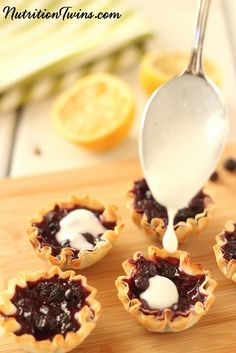 Lemon Wild Blueberry Mini Tarts | Only 47 Calories | Indulgent, Guilt-free, Sweet & Tart Combination | Super Satifsying | Easy to Make | Packed with antioxidants for healthy skin & blood flow | From @wildbberries  | For MORE recipes and tips please SIGN UP for our FREE Newsletter www.NutritionTwins.com