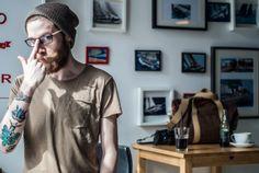 #backpack #coffee #cafe #polishboy #tatoos #canvas bag #table #wink #glasses #warsaw #poland #tchakon #camera #wall #pictures #pocket