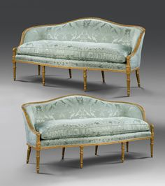A PAIR OF GEORGE III GILTWOOD SOFAS
