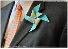pinwheel boutonniere     name tags for authors and guests?