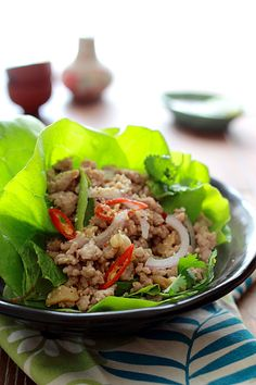Pork Larb Lettuce Wrap:  Larb is usually served with raw vegetables and makes a perfect filling for lettuce wraps.    The refreshing taste and freshness of the lettuce leaf pairs perfectly with the seasoned ground pork , while the spicy, tangy, and sweet dipping sauce completes this pork larb lettuce wrap recipe. #laos #thai #spicy