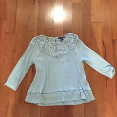 Lacey shirt a Lacey top light blue shirt, 100% rayon, medium fits like a small, 3 quarter length sleeves Forever 21 Tops Blouses