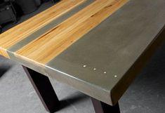 se Concrete Wood & Steel Dining Kitchen TableHandcrafted from concrete, wood and steel, this dining room table measuring in length x wide x tall was created using natural grey concrete contrasted with a center wo& Concrete Table Top, Concrete Wood, Concrete Design, Concrete Countertops, Wood Steel, Wood And Metal, Corten Steel, Dark Wood, Diy Tisch