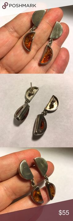 Great Hanging Sterling & Amber Earrings- Estate Very different pair of Sterling and Amber Earrings! Flecks of material catch the light in the amber adding interest. Half moon shaped top and dangle. Fine estate condition. Marked 925 on backs Jewelry Earrings