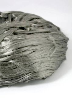 Spinnable Stainless Steel Fiber - Etextiles - Create Conductive Yarn!! This fiber is 100% metal and is 6.5 microns - that's softer than angora rabbit fiber! Spin it up or have it spun for you to create knitted jewelry, yarn, and more! You can even needle felt this onto gloves so you don't have to take them off in the cold to use your smart phone.