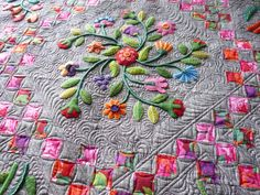 Appliques Quilts and More | Here is one of these flowers that has a cool little crocheted edge.