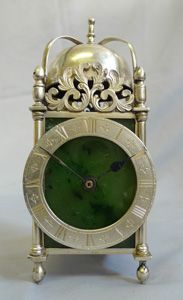 Antique English Asprey solid silver and moss agate mantel clock in form of a lantern clock.