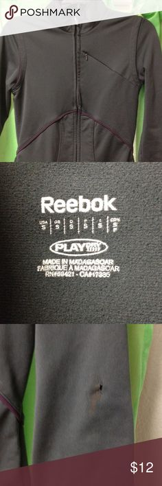 Reebok Zip up sweatshirt Reebok Play Dry zip up. Fitted. Charcoal grey with purple accents. Small tear on sleeve as shown in picture. Reebok Tops Sweatshirts & Hoodies