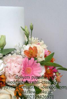 candles decorated in pastel colours with vendela roses ,white and pink paeonias,lisianthus ,gerberas alstromerias and asclepias by flowers papadakis  info@flowers4u.gr tel 00302109426971
