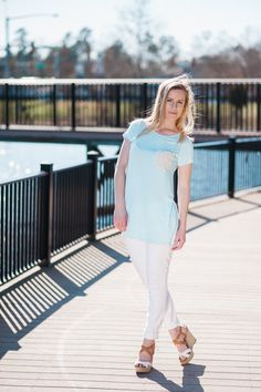 The Aqua Perfect Tee is stretchy and comfortable. With the lace detail pocket, you're going to love to wear this top all spring and summer long. Model is wearin