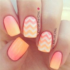 Melon and orange themed gradient nail art with thick zigzag line details in white polish.
