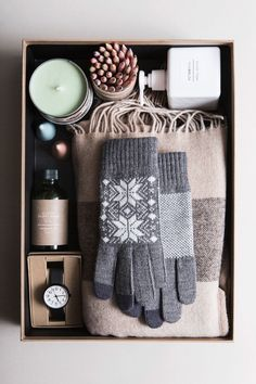 gift box for him with all the essentials such as scarf, mittens, candle, lotion, beard oil, and watch