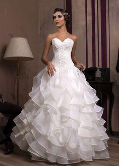 Luxusné svadobné šaty s volánovou sukňou a čipkovaným korzetom na predaj 592fd366f53