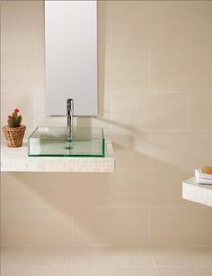 Create a neutral sanctuary in your bathroom with our range of Zeus tiles. Shown here: Zeus Beige.