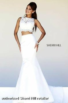 Here's where Diva meets Romantic and Sexy!  Stunning Ivory 2 piece mermaid dress by Sherri Hill with lacy illusion crop top (that's not too cropped) with tiny crystals all over it and fitted taffeta mermaid skirt to accentuate those curves!  Also available in red and royal blue!  #destination #bridal #receptiondress  #militaryball #2piece