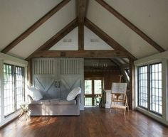 wood floors, sliding barn doors. beam ceiling.