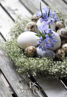 Lovely flower nest of Baby's Breath with eggs & small flowers nestled in the center!