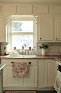 White kitchen with butcher block counters.