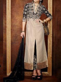 Elegant, classy and understated this beige and black suit set is perfect for a smart and modern woman. This attire with embroidered straight pants makes it more georgeous - See more at: http://www.akalors.in/Salwar-Kameez/Exquisite-Black-And-Beige-Contemporary-Faux-Georgette-Suit-id-1889044.html#sthash.v4wSFOjJ.dpuf