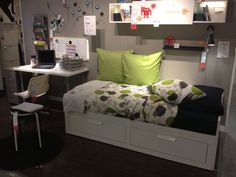 IKEA Brimnes day bed (unfolds into a full size) in a small combo guest room/office.