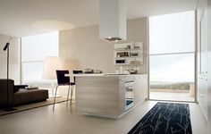 My Planet in tortora mat lacquered pine melamine and bianco embossed lacquered tall units.