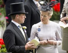 Quiet chat: The Queen's cousin Lady Helen Taylor chats to her grandson Peter Phillips as t...