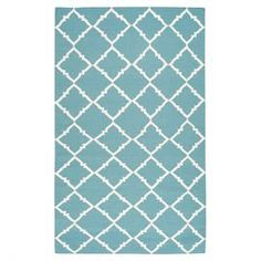 "Stylishly anchor your living room or master suite with this delightful flatweave wool rug, showcasing a lattice motif in dark Robin's egg blue.  Product: RugConstruction Material: 100% WoolColor: Dark Robin's egg blue and ivoryFeatures:  FlatweaveHand-wovenReversible No shedding Made in India No rug pad required  Pile Height: 0.157"" Note: Please be aware that actual colors may vary from those shown on your screen. Accent rugs may also not show the entire pattern that the corresponding area…"