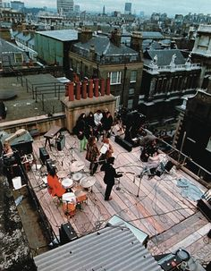 theswingingsixties:  The Beatles on the Apple rooftop, 1969.