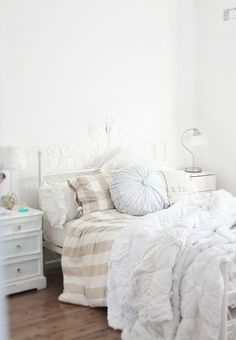 Ikea EMMIE RUTA duvet and shams with Anthropologie Rosette quilt and round pillow | A Beach Cottage