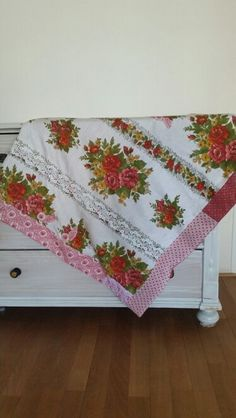 Blanket made from an vintage curtain, folkloric fabrics and lace. Available on Facebook : Hartelief.folkore.lifestyle.fashion