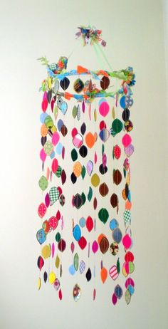 repeating shapes, embroidery hoop or wire hanger wrapped in fabric at top, fabric, cardboard, lovely! graceful!
