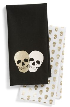 Add a spooky element to the home décor or wrap up the favorite bottle of witch's brew in this fun, Halloween-themed set of dish towels patterned in metallic skulls.
