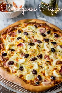 Portuguese Pizza | www.oliviascuisine.com In spite of the name, this is a typical Brazilian pizza with cheese, ham, olives, onion and hard boiled eggs! Delicious and nutritious! :) #pizza #brazilian #brazilianfood