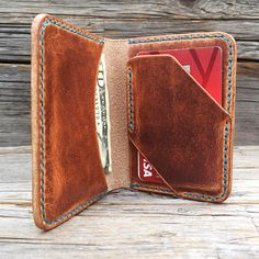 Seagull Bifold made in Horween English tan Dubin. The Seagull features a full length cash pocket on the left. On the right my holster style card holder. Holster holds 5-7 cards. Under the holster is a full length pocket of knickknacks and less used cards. Hand stitched in your