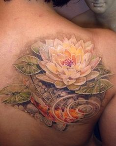 Beautiful white colored lotus flower tattoo. The white lotus is the symbol for innocence, purity and reaching of one's goals.