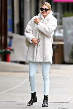 Gigi Hadid Likes Her Coats Fluffy, Her Phone Personalized #refinery29  http://www.refinery29.com/2015/04/85353/gigi-hadid-oversized-coat-outfit