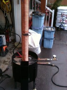 A rocket stove with a heat capture water coil for efficient heating of hot water.