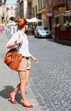 Shop this look on Lookastic: http://lookastic.com/women/looks/dress-shirt-shorts-ballerina-shoes-tote-bag-belt/11441 — White Dress Shirt — Dark Brown Leather Belt — Orange Leather Tote Bag — Tan Shorts — Red Leather Ballerina Shoes