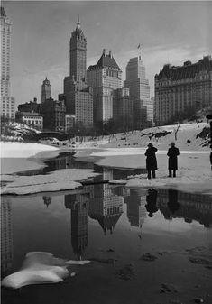 Samuel Gottscho: Plaza buildings, reflected in open lake, February 1933