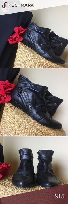 Nine West ankle Booties Great used condition. Has a Side zip detail. Some scuffing on back and toes from wear. Still have a Lot of wear left! Nine West Shoes Ankle Boots & Booties