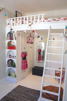 Bed over door with closet and bookshelves