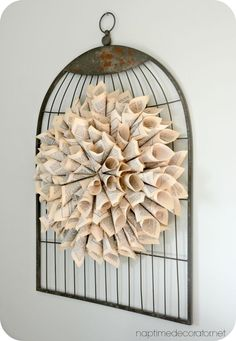 Free art! How to make this wreath with cardboard, an old book, and a glue gun.
