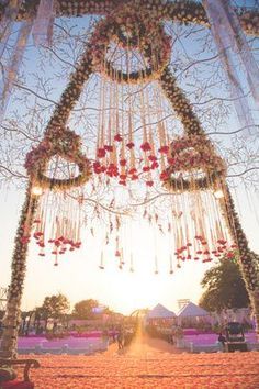 The view through this floral chuppah! Simply stunning! #IndianWedding #dayWedding #flower hangings and strings | curated by #WittyVows - The ultimate guide for the Indian Bride | www.wittyvows.com